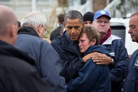 A rare photo of President Obama not offering comfort at the site of a natural disaster